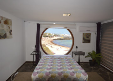 Double bed with round window