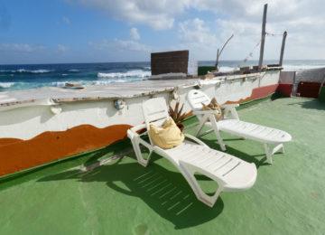 Sun loungers on an outdoor court