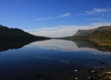 Dark blue lake with hills