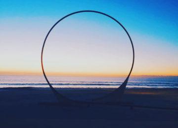 Big ring on the sandy beach at sunrise
