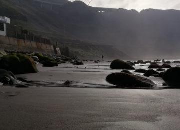 Sandy beach with large, round stones