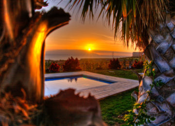 Sonnenuntergang beim Pool