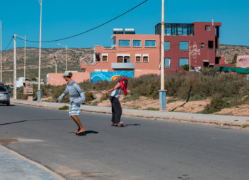 Two people skating on the street