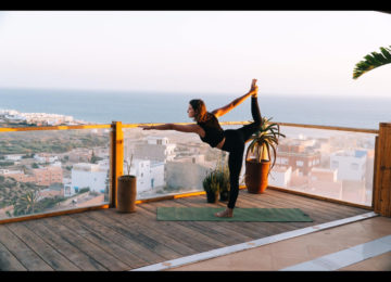 A woman in yoga pose on terrace