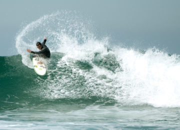 Surfer Makes Top Turn