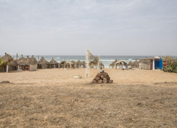 Senegalese huts and beach volley field on the beach