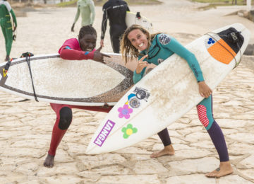 Surf trainer poses with local surfer