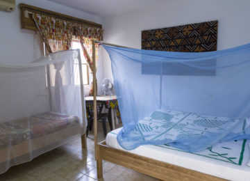 Large bed with mosquito net