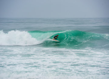 Surfers in the Barrell