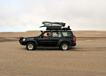 Jeep with surfboards on the roof