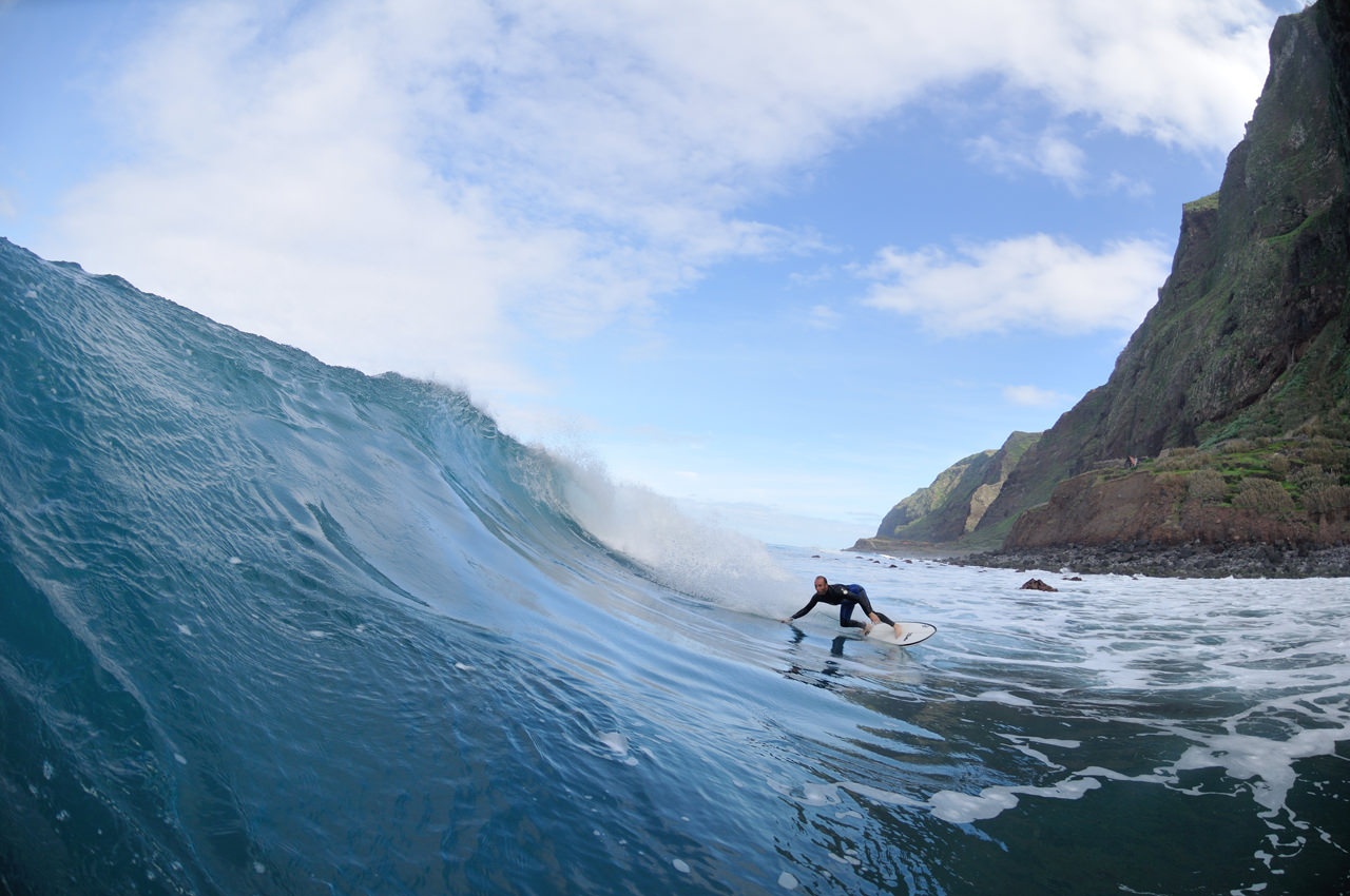 Surfers at the foot of the wave