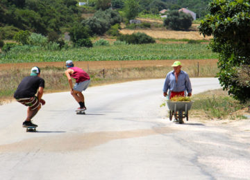 Skaters drive down the road