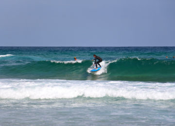 Surfer on a green wave