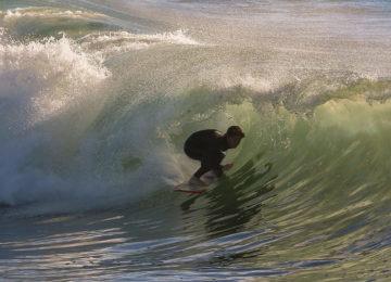 Surfers in Barrel