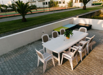 Outdoor area with large dining table