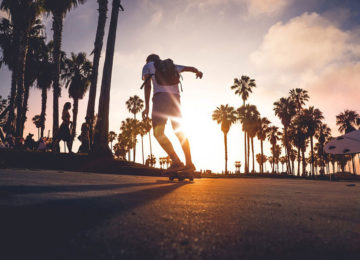 Skater rides towards the sunset