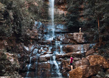Guests explore the waterfall