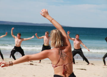 Warming up on the beach in front of the surf course