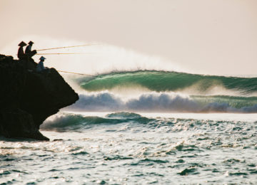 Cliffs fisherman in Bali with wave