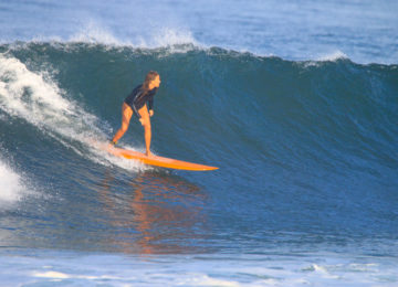 Head-high left wave with surfer