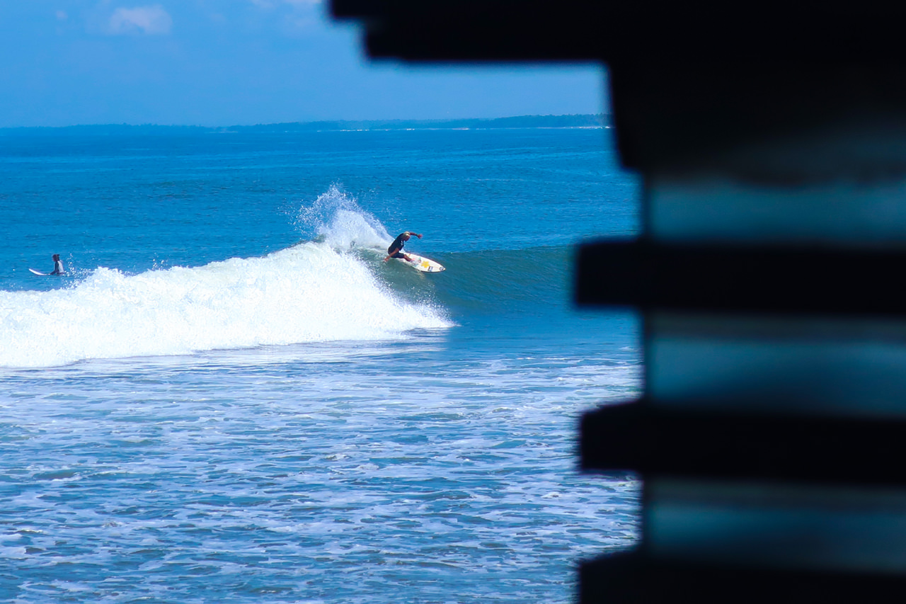 Surfer with turn at Medewi Point