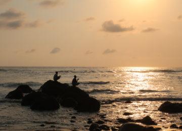 Fishermen at the beach at sunset