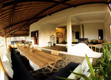 Dining table and chill out area at Bukit Surfcamp
