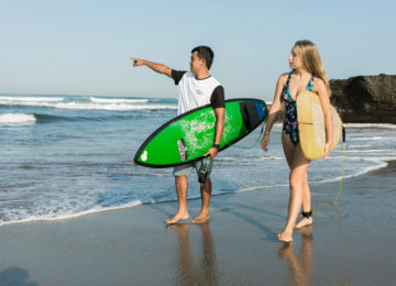 Surf lessons on a sandy beach in Bali