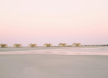 Die Bungalows bei Ebbe und Morgensonne