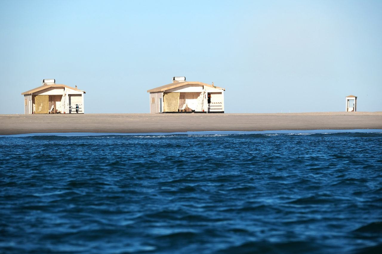 Two bungalows viewed from the sea