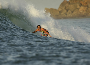 Surfer surf wave in Sumba