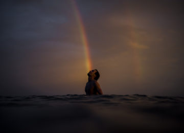 Surfer with rainbow during Sunset Session