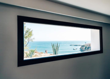 Window overlooking the garden and the sea