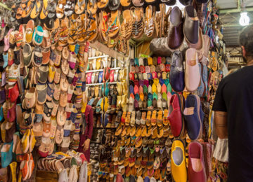 A market stall of leather shoes sold