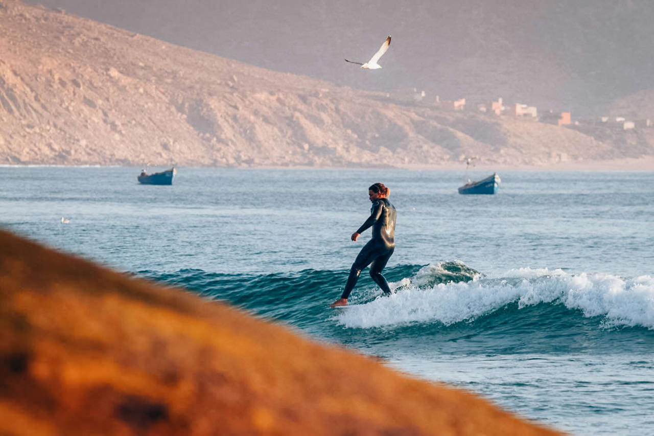 Surfer of Nah with Hang Five trick on surfboard