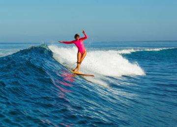 Longboarder surfs Red Island