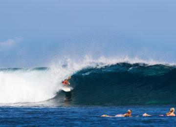 Surfer in barrel on red