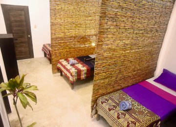 Mehrbettzimmer mit Einzelbetten im Surfhouse