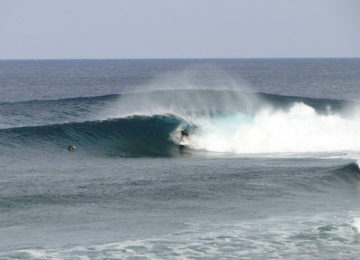 Surfers in Cloud9 Barrel on Siargao Island