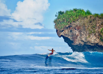 Surfer with turn at Rock Island Siargao