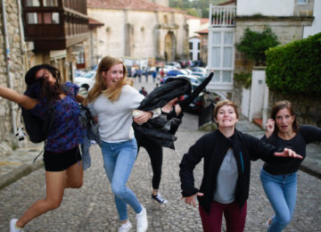 Cheerful people jump into the air in the city