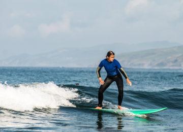 Beginner surfer in the wave