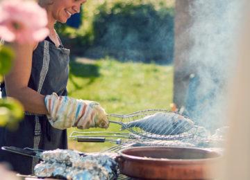 Woman grills fish