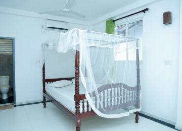 Double bed with mosquito net in Ahangama