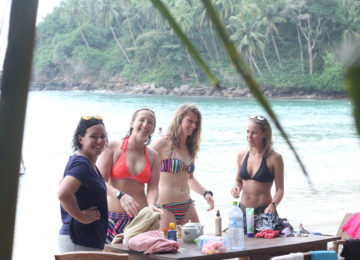 Guests of Surf and Yoga Camp on the beach