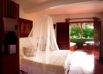 A double room with double bed and mosquito net