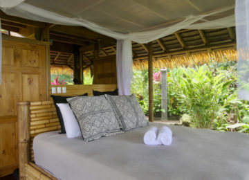 Double bed in tree hutbungalow bungalow