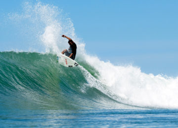 Surfers in right-hand wave in Costa Rica