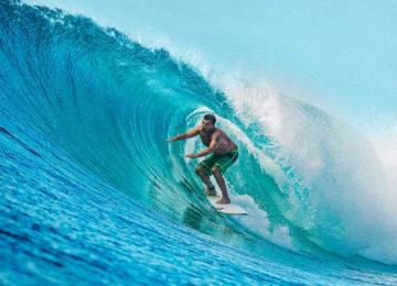 Surfers in Righthander Barrel
