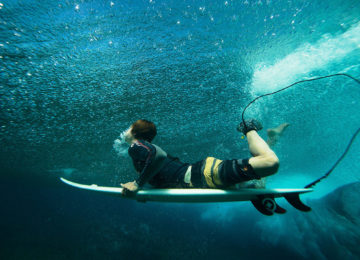 Surfers with Duckdive
